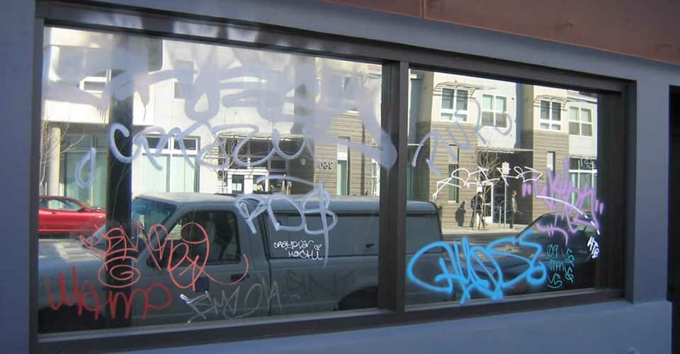 Graffiti on a window protected by window film