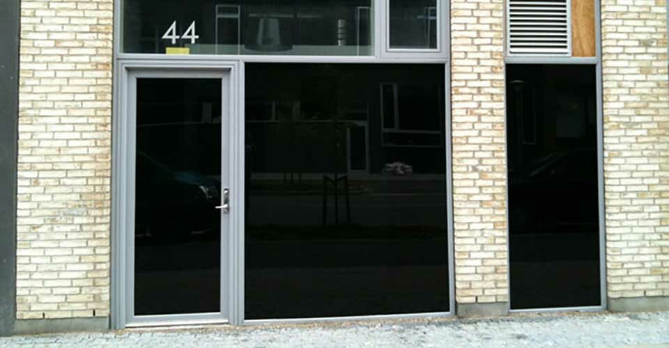 Blac our privacy film installed on building windows
