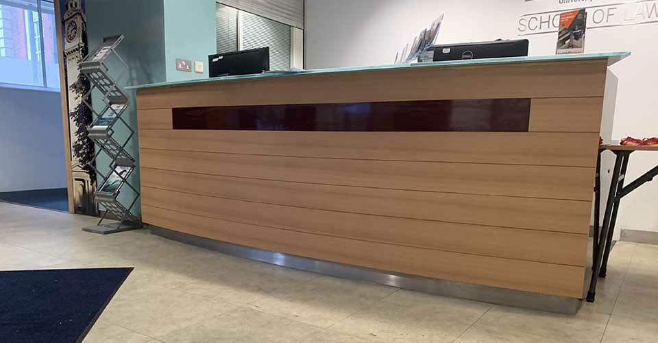 reception desk wrapped in a wood effect vinyl