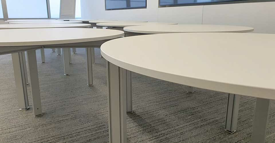 Matte white commercial wrap on tables at Apple HQ