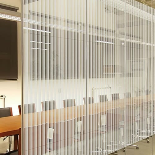 Boreal striped patterned window film on a glass partition