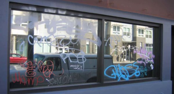window with anti graffiti glass film installed and graffiti on the film