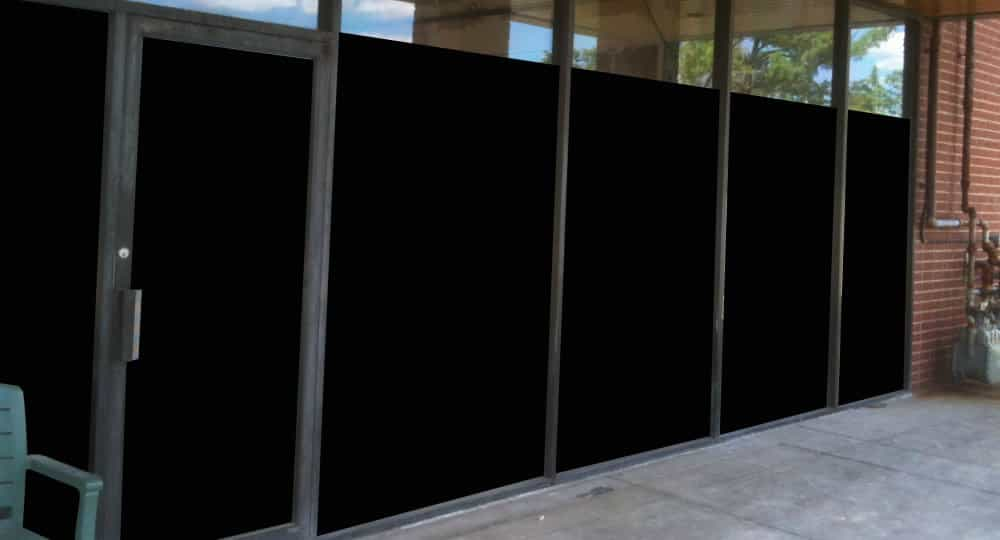 blackout glass film installed on a row of windows and doors