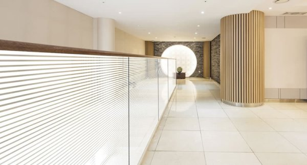 Bold stripe window film installed on glass partition in a hallway