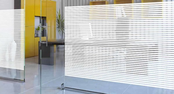 Striped window film installed on a glass partition