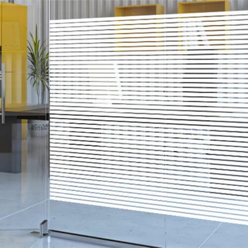 Bold stripe decorative window film on a glass partition