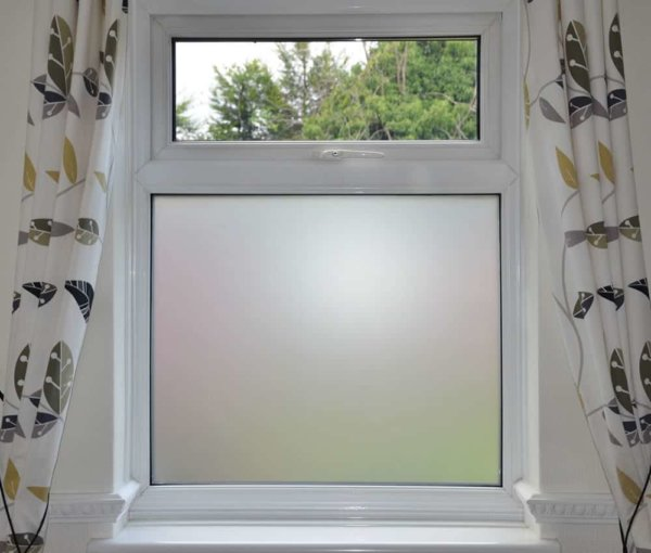 Frosted vinyl installed on bottom pane of a house window