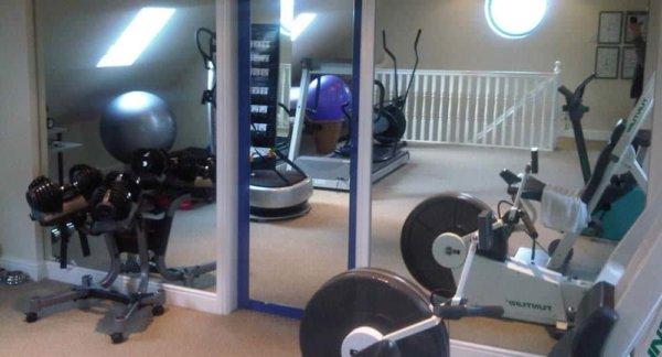 silver mirror window film installed on gym windows