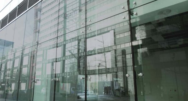 Multiglass solar window film installed on large glass fronted building