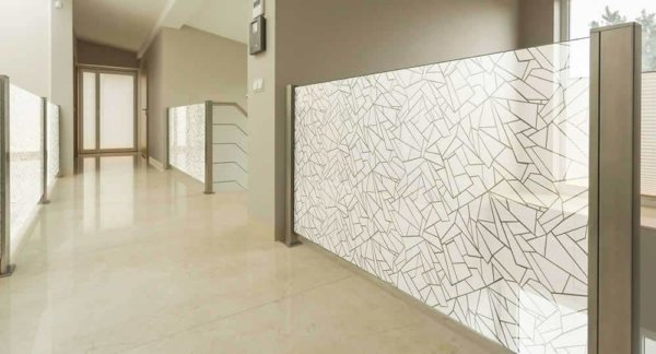 vitra frosted patterned window film installed to landing glass partitions