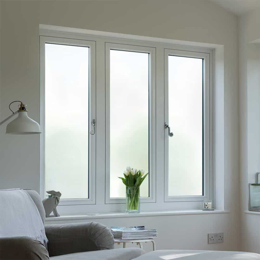 White frosted window film on living room windows