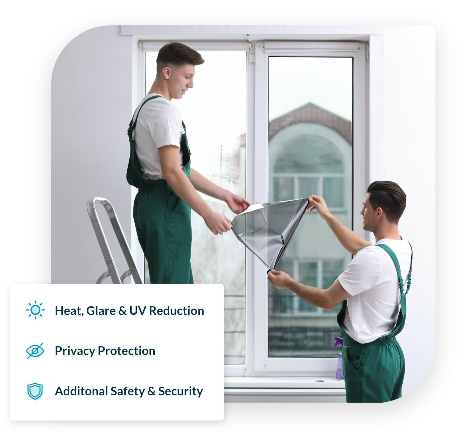 An image of 2 friendly workers installing quality window film in the UK, to block glare and increase privacy