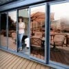 Bronze reflective window film installed on a patio door