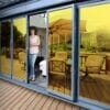Gold reflective window film installed on a patio door
