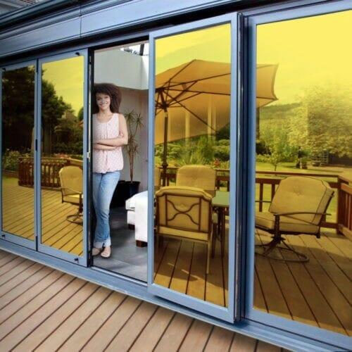 Gold reflective window film installed on a patio door