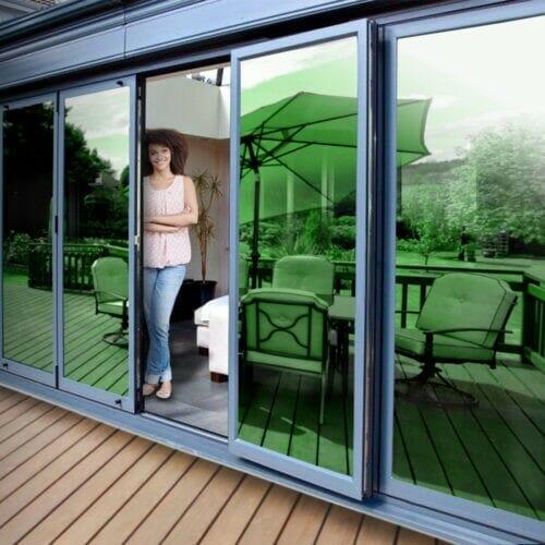 Green mirror window film installed on a patio door