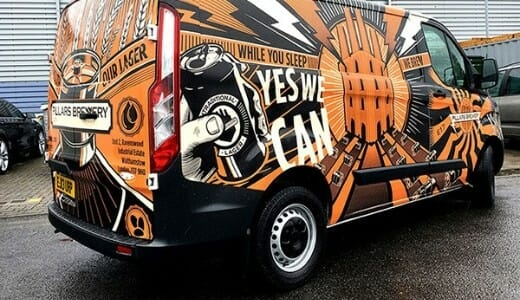 An image of a van with bright and colourful van wrapping